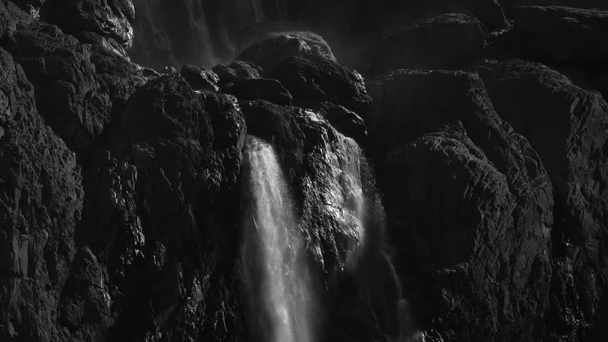 Epic slow motion detail of top of Gavarnie Falls, Cirque de Gavarnie, Pyrenees, France. Black and white.