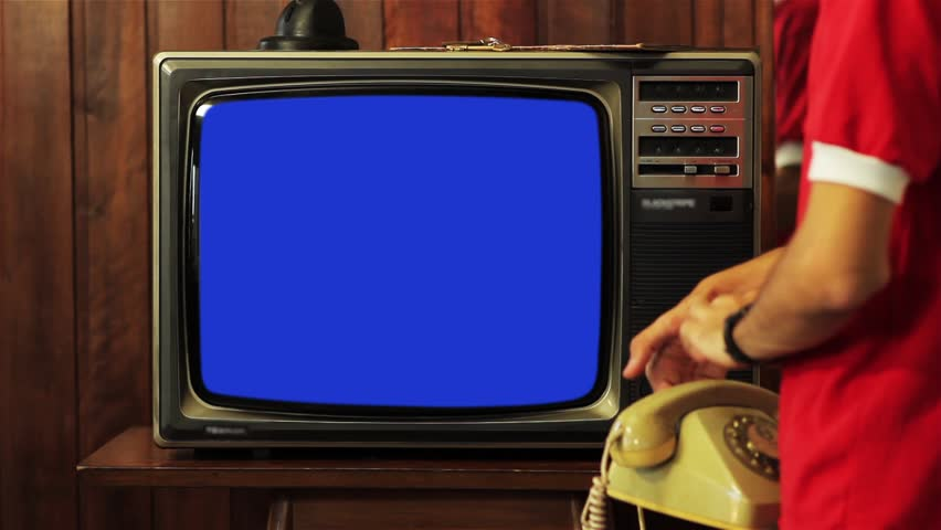 """Kid Talking on Vintage Phone and Watching Old 1980s Tv with Blue Screen. Ready to Replace Blue Screen with Any Footage or Picture you Want. You Can Do it With """"Keying"""" (Chroma Key) Effect. 