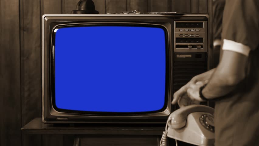 """Kid Talking on Vintage Phone and Watching Old 1980s Tv with Blue Screen. Ready to Replace Blue Screen with Any Footage or Picture you Want. You Can Do it With """"Keying"""" (Chroma Key) Effect. Sepia Tone. 