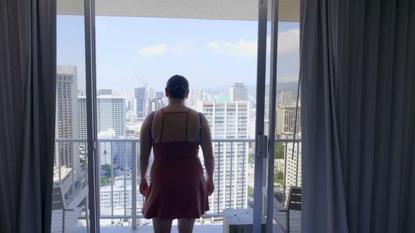 Woman starting a beautiful day in Hawaii in 4K slow motion 60fps | Shutterstock HD Video #1020984367