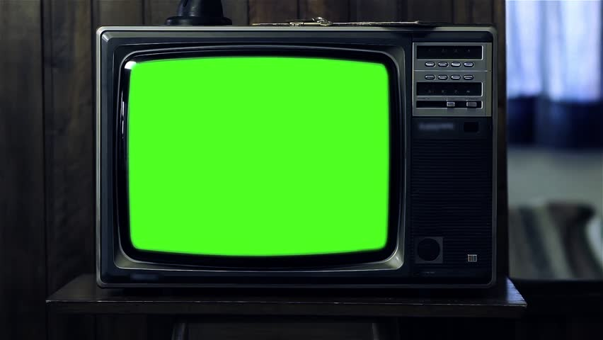 "1980s Tv with Greenscreen in Dark Room. Ready to Replace Green Screen with any Footage or Picture you Want. You can do it with ""Keying"" (Chroma Key) effect. 