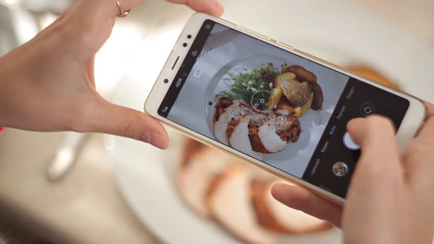 Woman Hands Taking Photos Of Dinner Food By Smartphone. Closeup