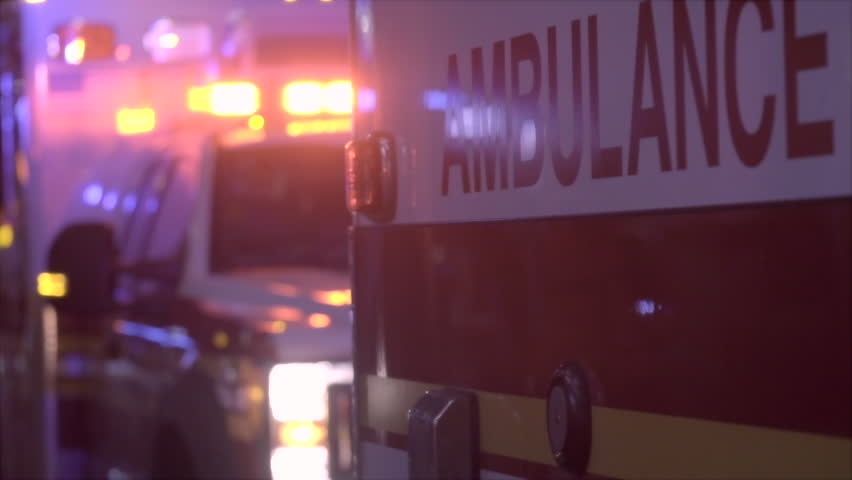 Ambulance at night with flashing lights