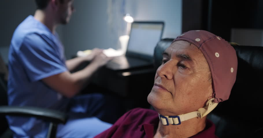 Elderly male patient with Alzheimer's illness, undergoing electroencephalogram examination Senior man with a nurse in clinic for medical evaluation using EEG. Brain illness prevention using technology Royalty-Free Stock Footage #1020997993