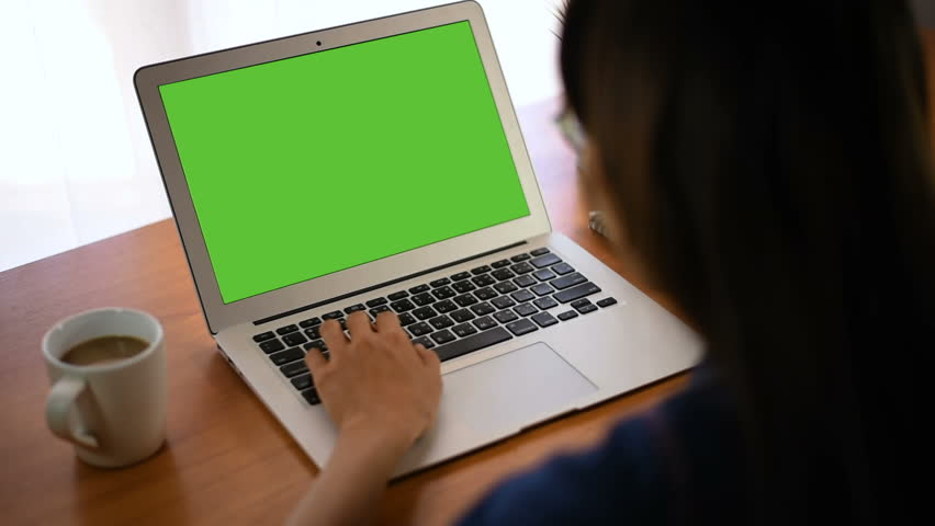 Young business start up, Young Owner Woman Start up for Business Online Working at home, Over the shoulder shot of a woman typing on a computer laptop with a key-green screen in home. | Shutterstock HD Video #1021001212
