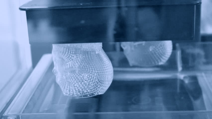 Stereolithography DPL, SLA 3d printer creating shape by UV polymerization. close-up. Progressive modern additive technology 3D printing.