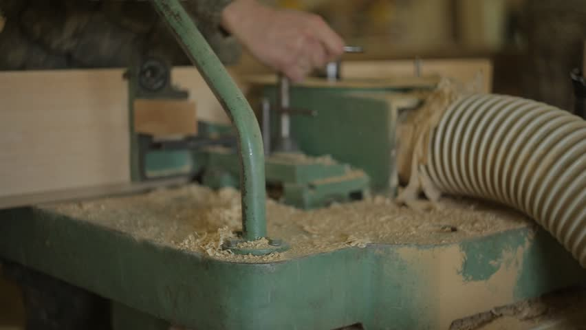 Workers on the sawmill change the cutters in the edging machine and set up the machine for wood processing, close-up, joiner, power-saw | Shutterstock HD Video #1021010254