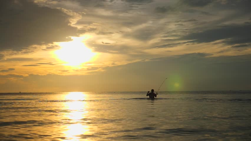 Fisherman Fishing With Rod In The Sea At Sunset | Shutterstock HD Video #1021019155
