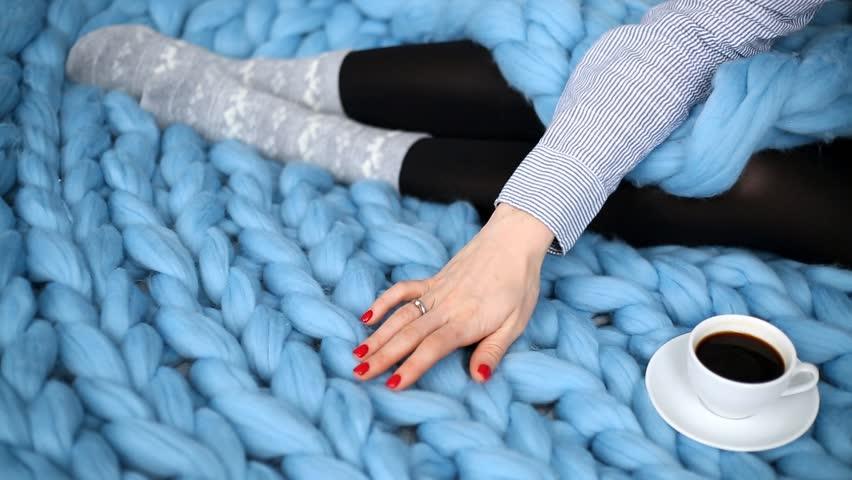 Woman's hand stroking blue cozy merino wool plaid | Shutterstock HD Video #1021020346