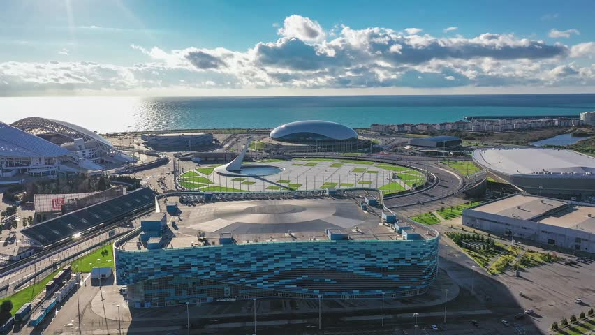 Sochi Adler, Russia - December 14, 2018 Panoramic view from the quadrocopter to the Sochi Olympic Park. Aerial. Blue skies, football stadium Fisht, the ice Palace Hockey, iceberg, square medal Plaza.