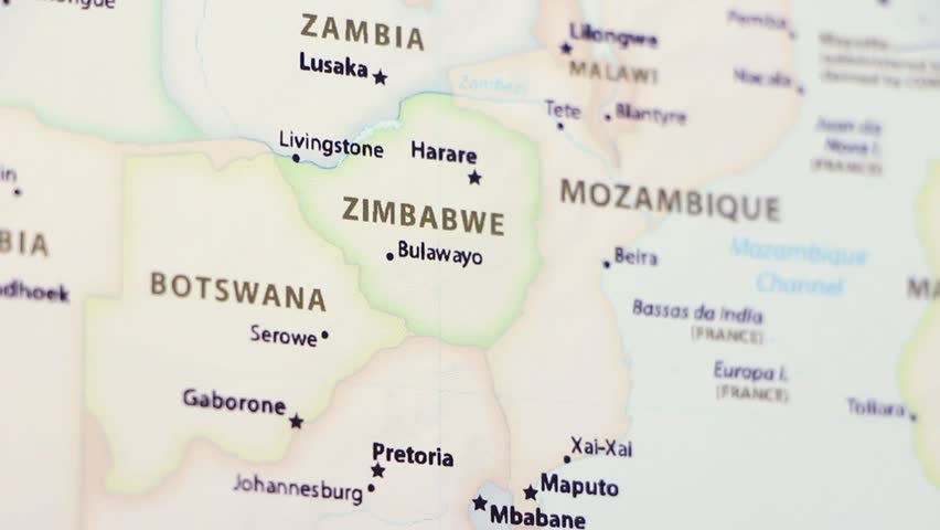 Zimbabwe on a political map of the world. Video defocuses showing and hiding the map. Royalty-Free Stock Footage #1021098559