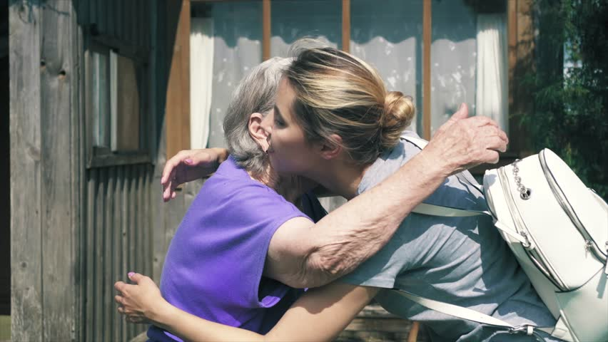 An older woman met her granddaughter. They hug and cry with happiness. Grandmother with family | Shutterstock HD Video #1021110523