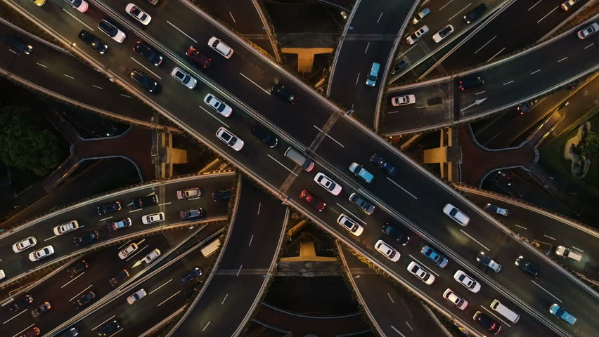 Rising drone shot reveals spectacular elevated highway and convergence of roads, bridges, viaducts in Shanghai at night, transportation and infrastructure development in urban China | Shutterstock HD Video #1021117075