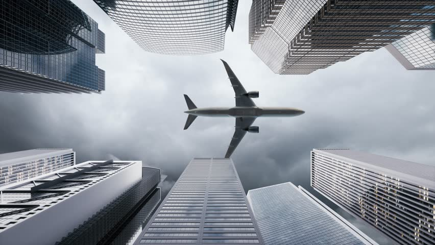 Airplane flies to the tops of the skyscrapers. Look up view at skyscrapers and flying plane. | Shutterstock HD Video #1021119103
