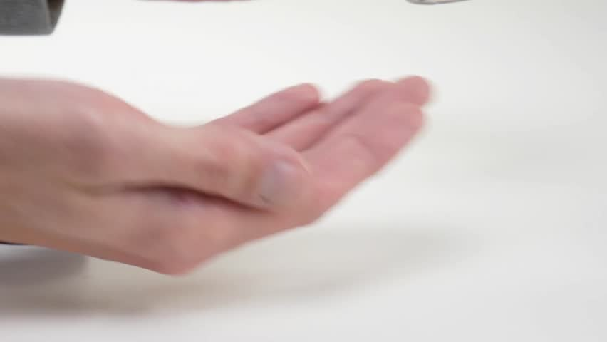 The man pours pills in his palm. Pharmacy | Shutterstock HD Video #1021129087