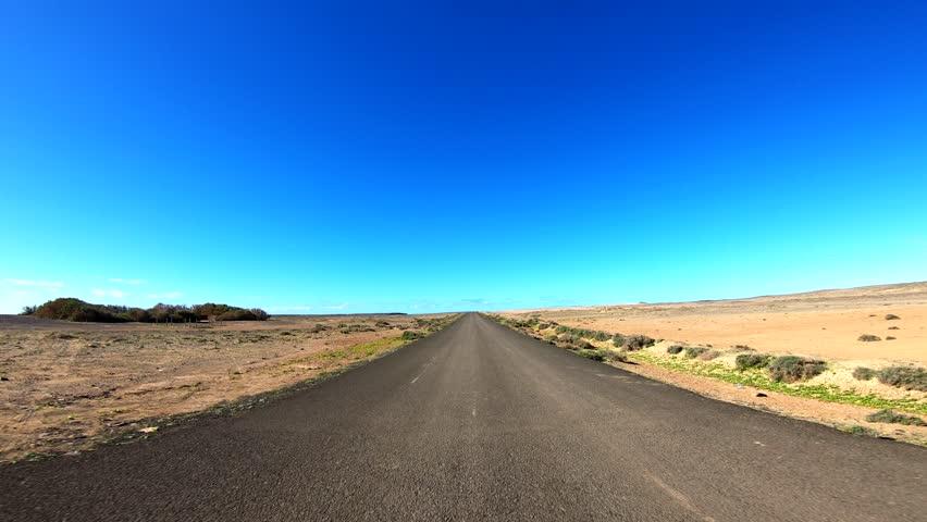 Adventure Travel in a desert. POV Video Footage in 4K. Fuerteventura | Shutterstock HD Video #1021174783