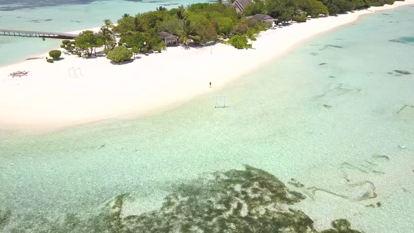 Drone flying to tropical island in Maldives. White beach, water villas, window in blue water and model. | Shutterstock HD Video #1021175290