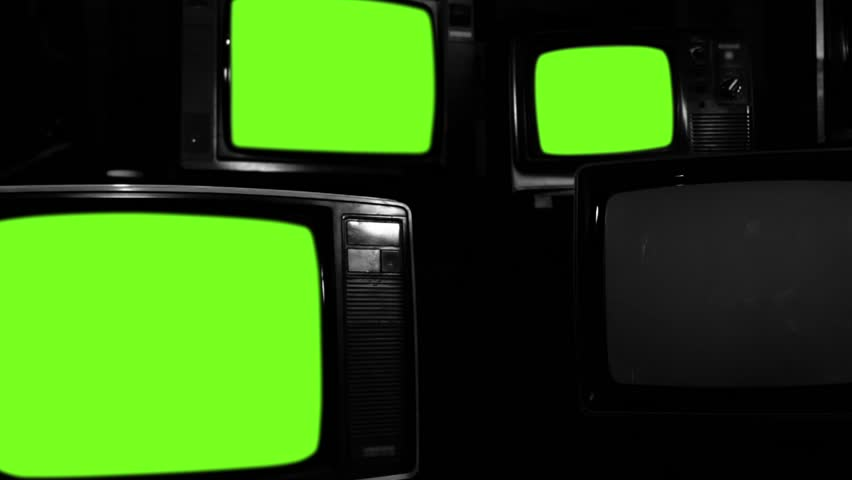 """Old Tvs Turning On Green Screen. Black and White Tone. Zoom Out. Ready to Replace Green Screens with any Footage or Picture you Want. You can do it with """"Keying"""" (Chroma Key) effect. 