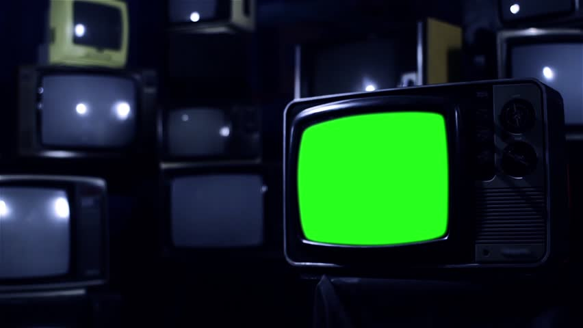 "Old Tv with Green Screen and many Old Tvs. Dark Tone. Zoom Out. Ready to Replace Green Screen with any Footage or Picture you Want. You can do it with ""Keying"" (Chroma Key) effect.  
