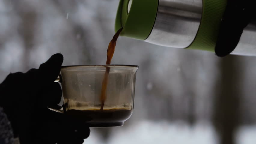 Coffee. Coffee and thermos on the background of the winter forest | Shutterstock HD Video #1021195096