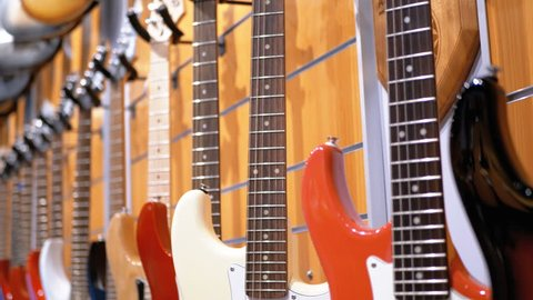 Many Electric Guitars Hanging in Stock Footage Video (100% Royalty-free)  1021355494 | Shutterstock