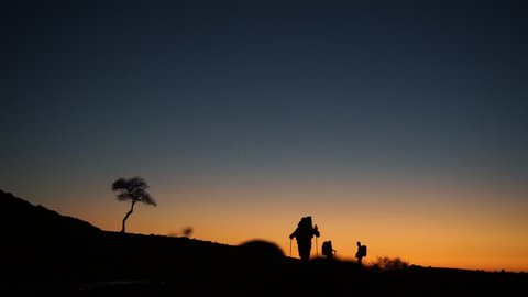 Backpackers and sunset sky
