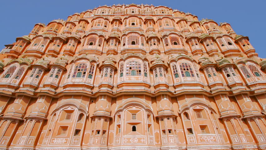 """Tilt Up Shot of Hawa Mahal. Hawa Mahal or """"Palace of Winds"""" is a palace in Jaipur, India. It is constructed of red and pink sandstone. The palace sits on the edge of the City Palace, Jaipur,Rajasthan."""