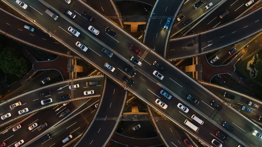 Overhead drone shot of cars driving over elevated highway and busy interchange in Shanghai, China | Shutterstock HD Video #1021274983