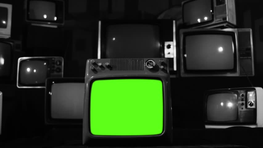 "Vintage Tv Turning On Green Screen. Black and White Tone. Zoom In. Ready to replace green screen with any footage or picture you want. You can do it with ""Keying"" (Chroma Key) effect. 