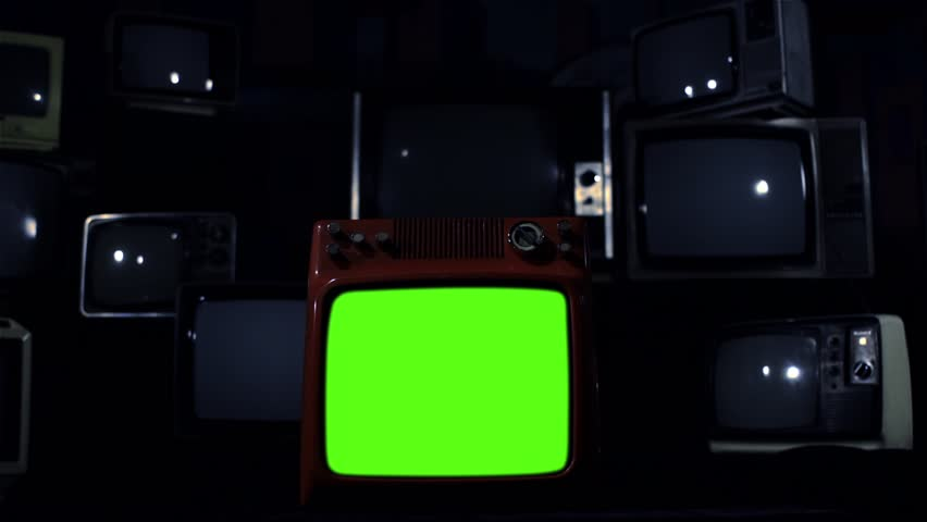 "Vintage Tv Turning On Green Screen. Dark Night Tone. Ready to replace green screen with any footage or picture you want. You can do it with ""Keying"" (Chroma Key) effect. 