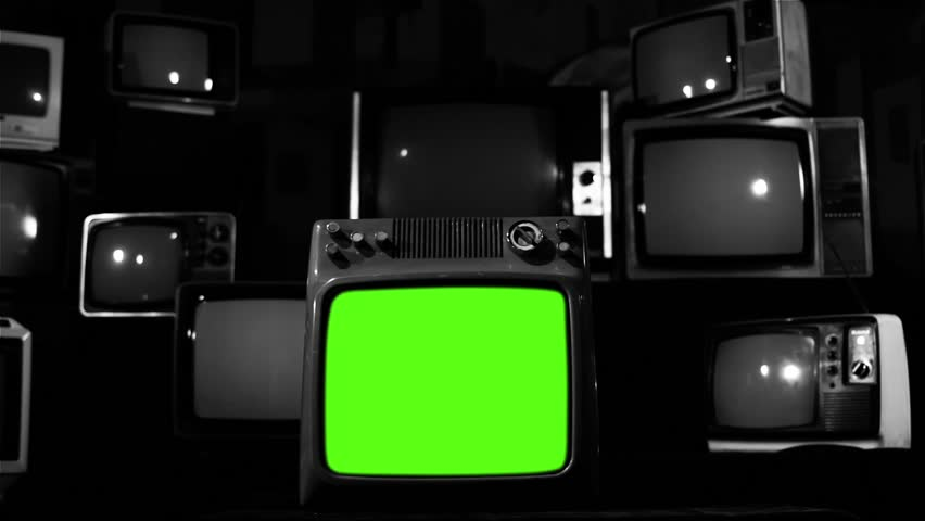 "Vintage Tv Turning On Greenscreen With Static. Noir Tone. Ready to Replace Green Screen with any Footage or Picture you Want. You can do it with ""Keying"" (Chroma Key) effect. 