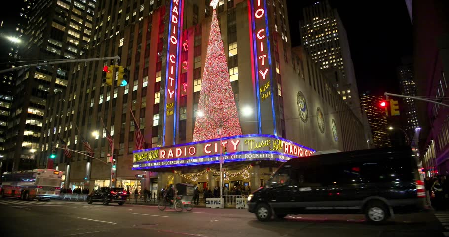 NEW YORK CITY - DEC. 25, 2014: New York City landmark, Radio City Music Hall in Rockefeller Center decorated with Christmas decorations in Midtown,  Manhattan NYC.