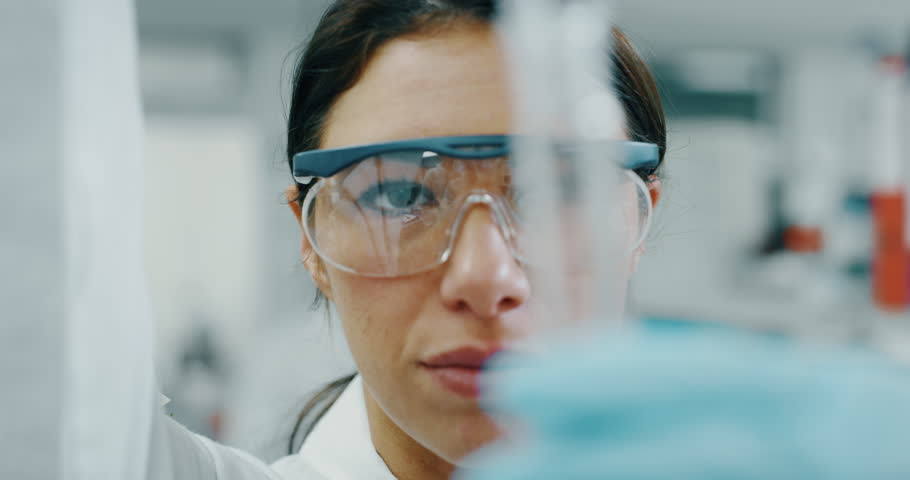 Portrait of female scientist with a pipette analyzes a liquid to extract the DNA and molecules in the test tubes in laboratory. Shot in 8K. Concept: research,biochemistry, pharmaceutical medicine Royalty-Free Stock Footage #1021305646