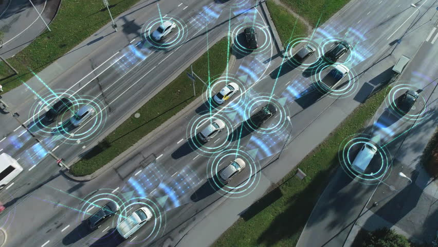Aerial Drone View: White Autonomous Self Driving Car Moving Through City. Concept: Artificial Intelligence Scans Surrounding Environment, Detecting Cars, Avoids Traffic Jams and Drives Safely.