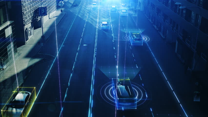 Aerial Drone Shot: Autonomous Self Driving Cars Moving Through City. Concept: Artificial Intelligence Scans Cars and Pedestrians, Following Movement and Showing Data.