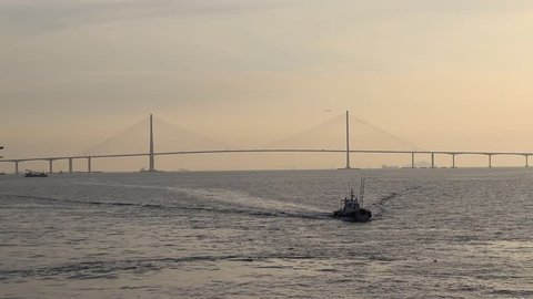 Scenery with Incheon Bridge and ship. Beautiful sea bridge. Incheon Bridge with sunset.
