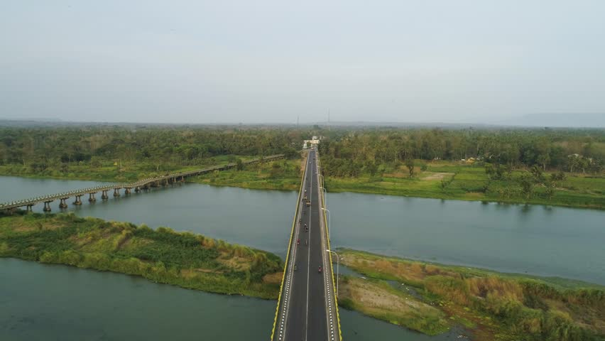 Cinematic aerial footage of old and new bridge with traffic in green countryside | Shutterstock HD Video #1021311961