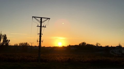Electricity line at sunset
