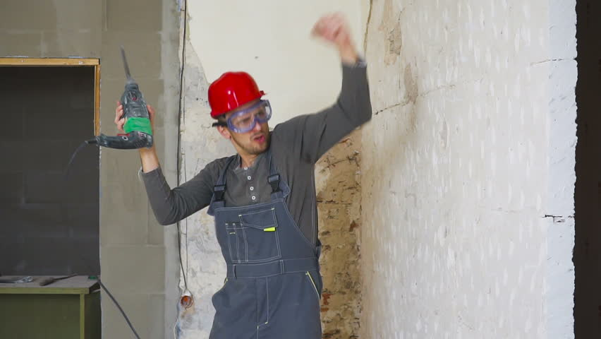 Young architect dancing in the construction building.   Shutterstock HD Video #1021367644