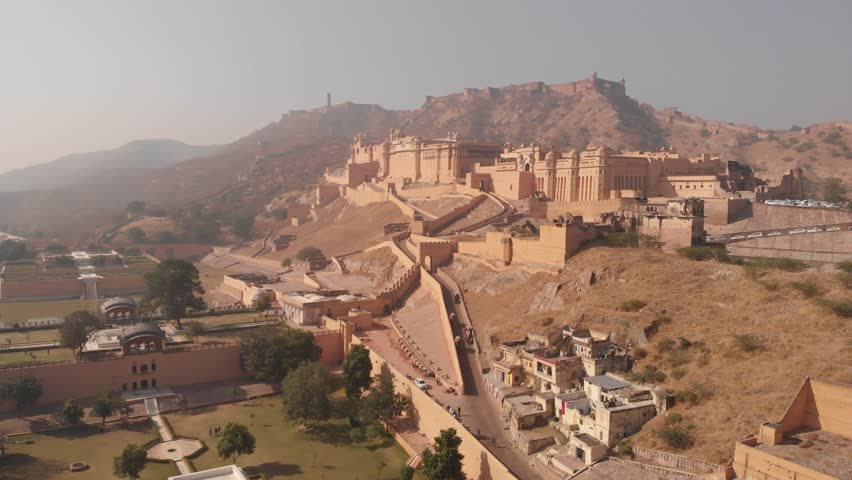 Aerial panoramic view of Amber (Amer) Palace/Fort in historical city of Amer, UNESCO World Heritage Site - near Jaipur (Pink City), Rajasthan, landscape panorama of Northern India, Asia from above