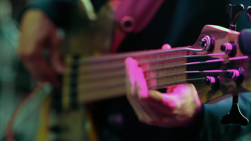 Man bass guitarist playing electrical guitar