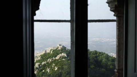 Magnificent view of beautiful nature through window of old castle in Sintra, Portugal