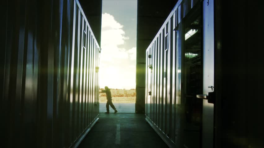 Worker opening the Gate in a Server Room or Data Center at Sunset.    Shutterstock HD Video #1021422193