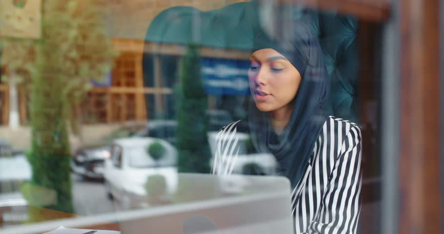Female muslim hr manager at job interview, talking to a candidate and smiling, - modern muslim, human resources concept 4k   Shutterstock HD Video #1021483423
