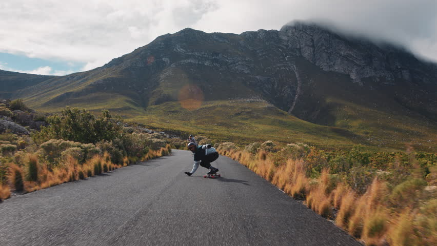 Young friends longboarding together riding fast on beautiful countryside road enjoying extreme sport cruising downhill doing tricks slow motion | Shutterstock HD Video #1021486111