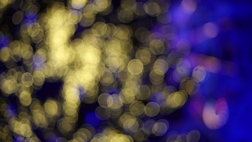 Festive Christmas city lights decorations in blur. Abstract sparkling background. Christmas fair. Blue and gold sparkles. Bokeh. 4k | Shutterstock HD Video #1021492747