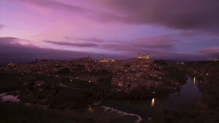 Time lapse of the Toledo old town cityscape at dusk, Spain
