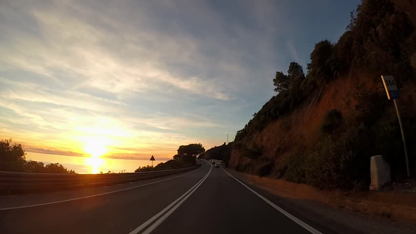 Driving in scenic highway at sunset, Tuscany, Italy  | Shutterstock HD Video #1021511134