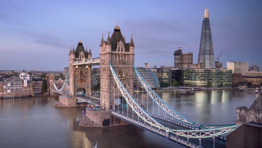 Time lapse London skyline with illuminated Tower bridge in sunrise time, UK