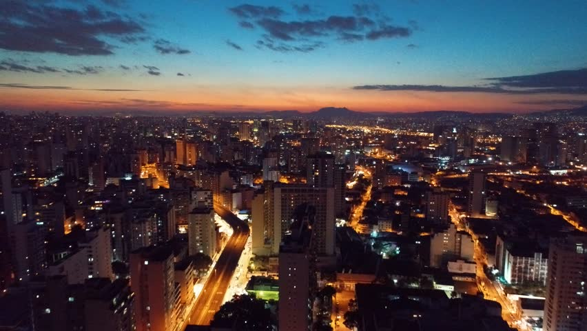 Cityscape skyline. Aerial view of sunset skyline Sao Paulo city, Brazil. Sunset scene. City landscape. Business city. Business travel. Colorful sunset. Colored sky. Dusk skyline. Sunset city skyline.